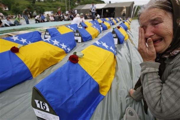 A Bosnian Muslim woman cries during a funeral for 31 Bosnian Muslims killed at the beginning of Bosnian 1992-95 war, in the Bosnian town of Bratunac, 100 km's east of Sarajevo, Bosnia,on Wednesday, May 12, 2010. All victims including two girls 7 and 4 years old were exhumed from mass graves and identified by DNA method.(AP Photo/Amel Emric)